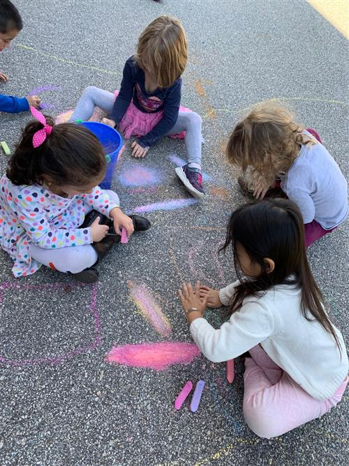 students chalk drawing