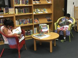 Two students reading inthe  Ephesus Elementary Library