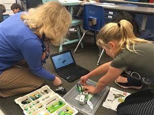Student and Teacher programming robotics