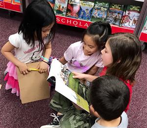Students reading at the Book Fair.