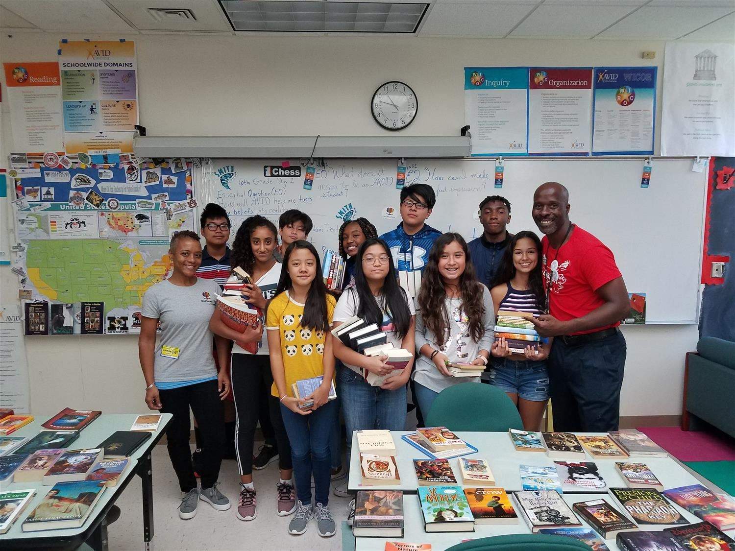 Zeigler and AVID students with Books