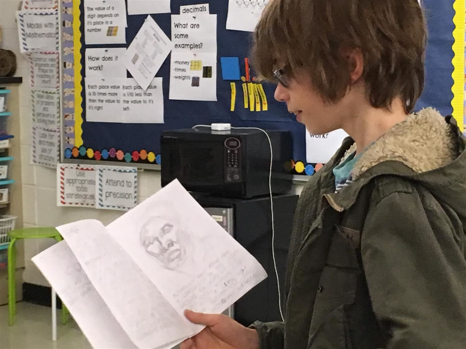 CES 5th grader reads his own book