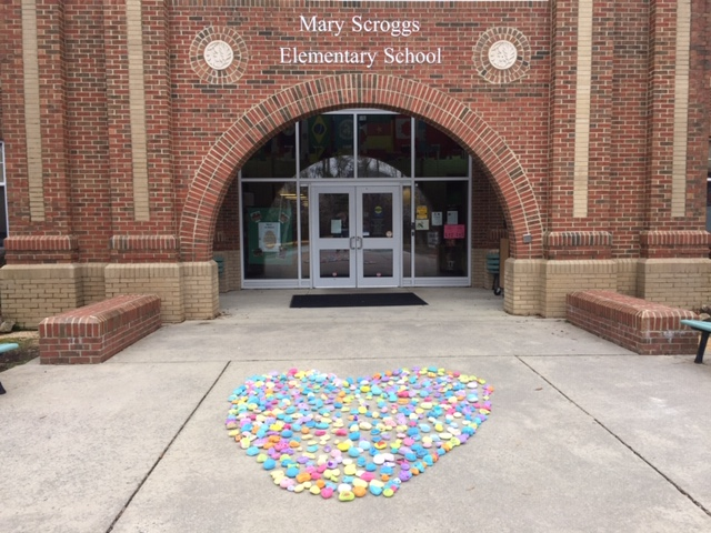 Kindness rocks heart in front of Scroggs