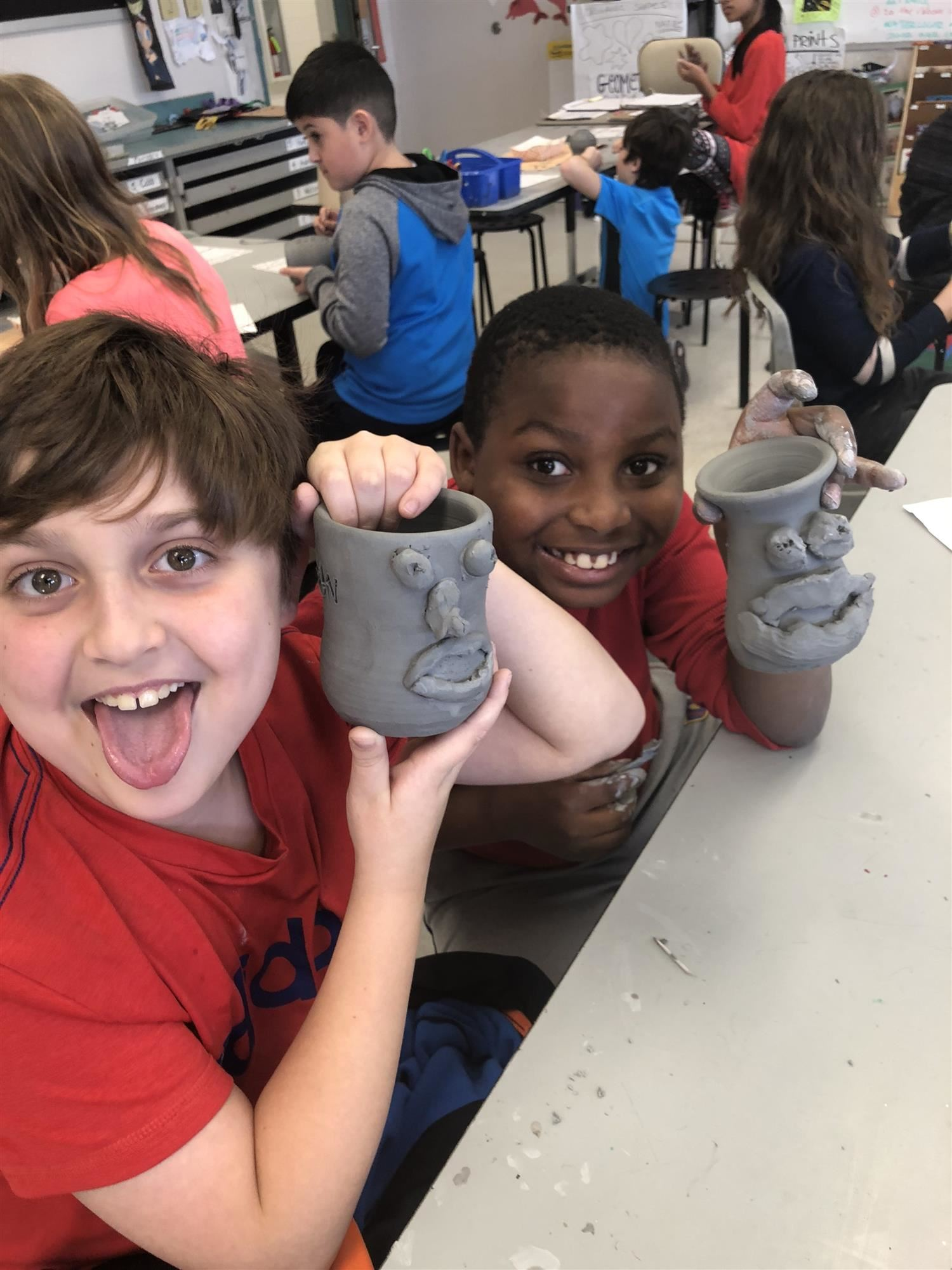 MES pair of students with face jugs