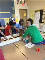Dan and students build a bench