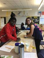 NS students grinding corn