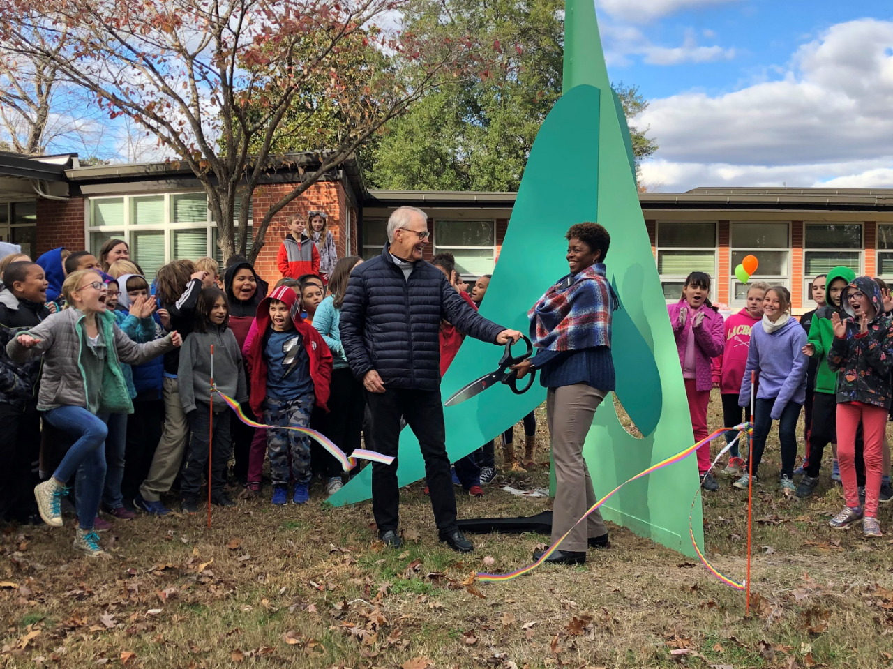 Sculpture ribbon cutting at Estes Hills