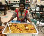 African student with food at Smith