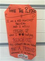 Take the Pledge poster at MES